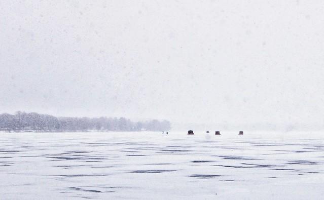 Ice fishing in the snow, Bear Lake, Michigan