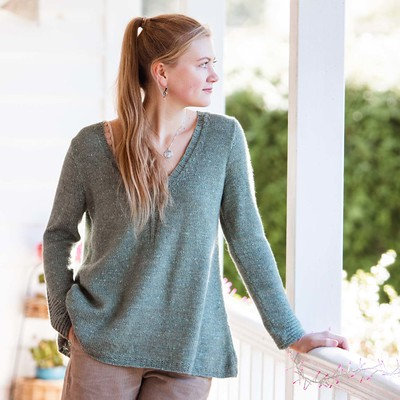 Rathbone is a v-neck sweater with a flattering a-line shape, subtle texture on the sleeves and stockinette stitch on the main body.