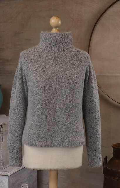 Austrina by Allison Jane is a lace yoke sweater with a relaxed funnel neck. Knit with The Fibre Co.'s brushed yarn Cirro, this romantic pullover is soft as a cloud. Available as a PRE-ORDER Kit.