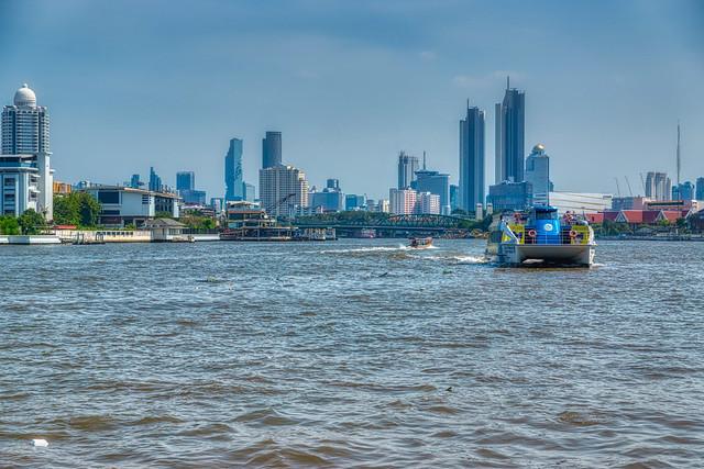 Chao Phraya river with city skyline in Bangkok, Thailand