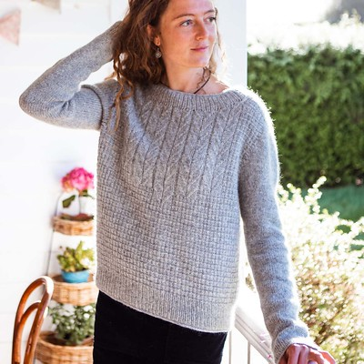 Brandelhow is a modern take on a fisherman's sweater featuring panels of mock cables and a textural broken rib.