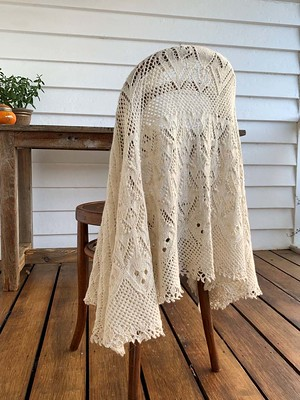 Lingholm is a cape-length oval shawl, knit from the back of the neck outwards.