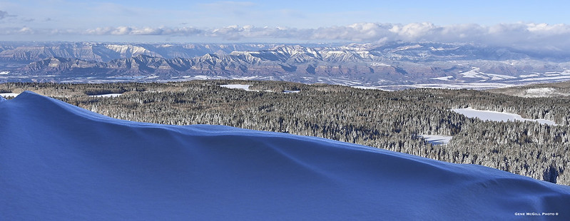 The Roan Plateau and Battlement Mesa viewed from a snow drift at the very north edge of Grand Mesa