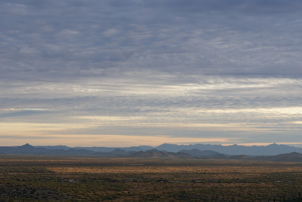 Layers of clouds hover above the mountains near sunset, looking south from the Go John Trail in Cave Creek Regional Park in Cave Creek, Arizona on January 31, 2021. Original: _CAM0063.arw