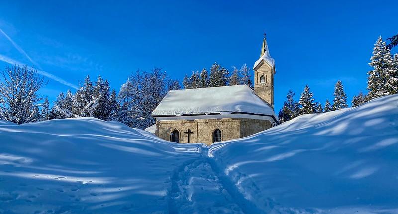 Chapel in the snow on Nußlberg mountain near Kiefersfelden in Bavaria, Germany