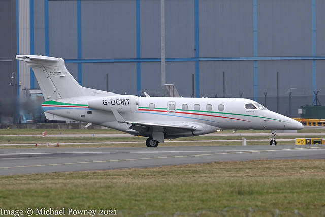 G-DCMT - 2013 build Embraer 505 Phenom 300, vacating Runway 05L on arrival at Manchester
