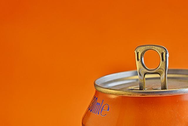 Orange Can against Orange Background