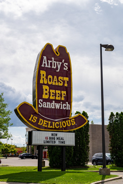 Crystal, Minnesota - July 21, 2019: Classic cowboy hat old-school style Arby's Roast Beef sign for the fast food restaurant. Portrait view