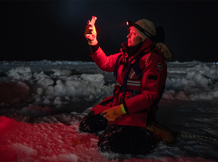 a woman holds a block of ice