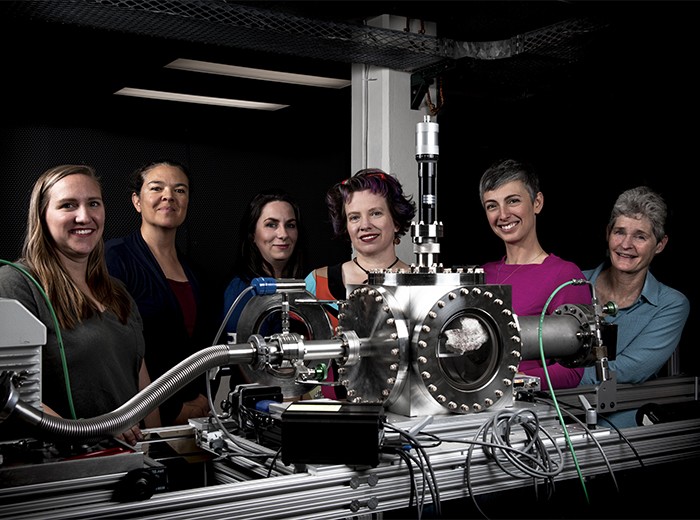 six women in front of supercam