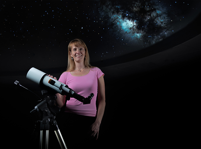 woman behind telescope