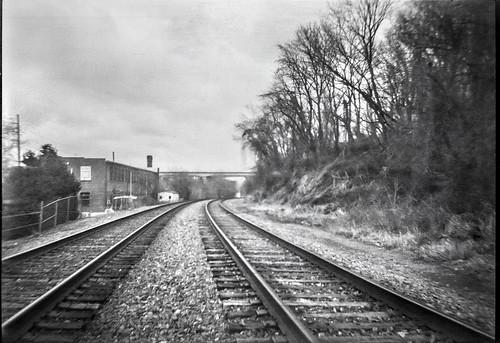 railroadtracks converging riverdistrict overpass overcast asheville northcarolina afgachief berggerpancro400 ilfordilfosol3developer boxcamera 6x9 afga mediumformat monochrome monochromatic blackandwhite 120 120film film analog landscape