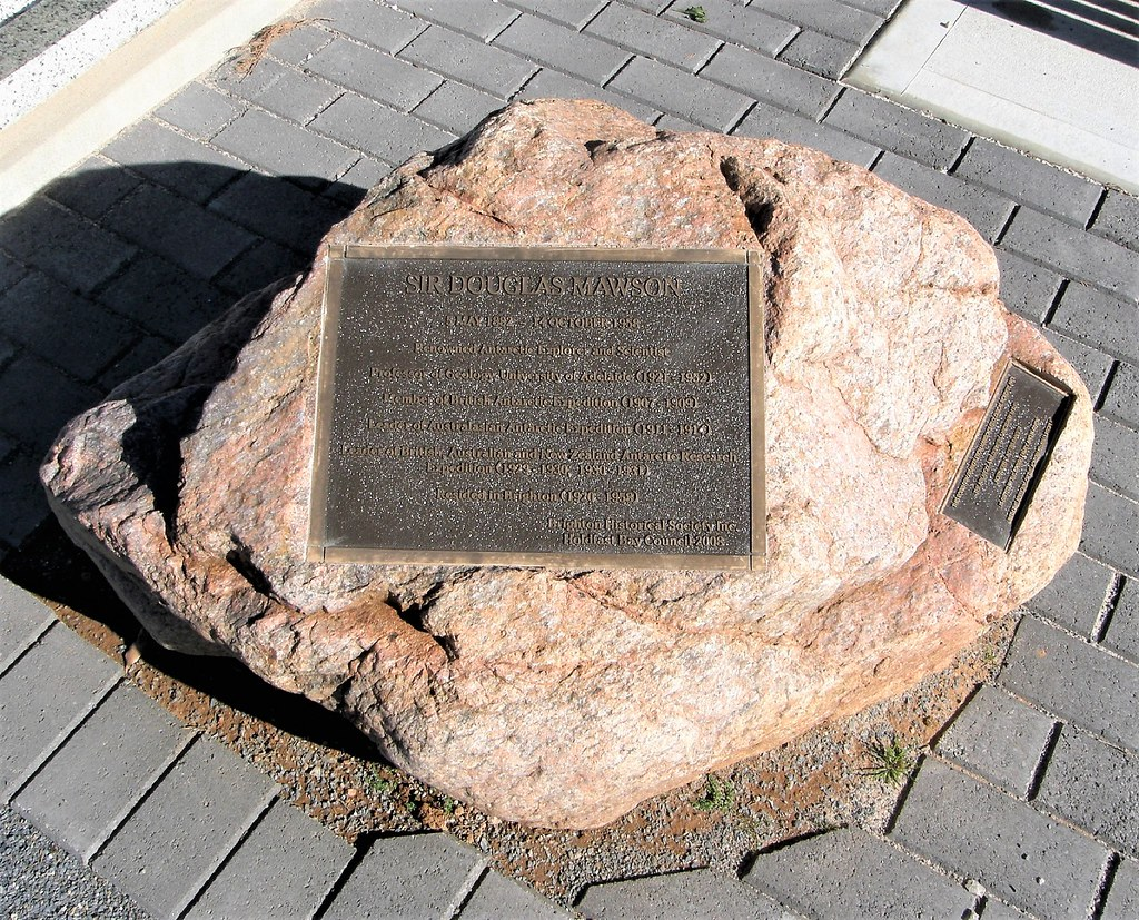 Brighton / Plaques on Porphyry Granite given by the Sprigg family, at St Jude's Cemetery / Tribute to Sir Douglas Mawson, Antarctic explorer and scientist. South Australia