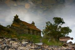 Reflection on abandoned cottage