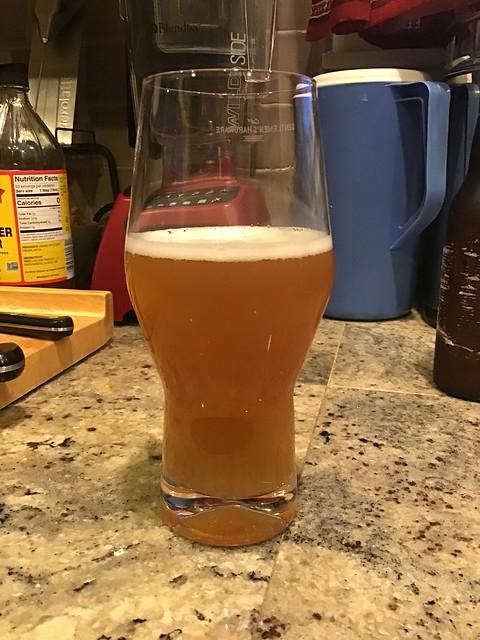 Cream ale in glass on countertop