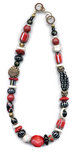 Zanzibar, an asymetrical necklace in glass, coral & bone with trade beads, ceramics & brass from Africa