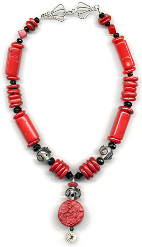 Marco Polo: a necklace in Mediterranean coral and Venetian glass beads combined with a red Cinnabar pendant from China