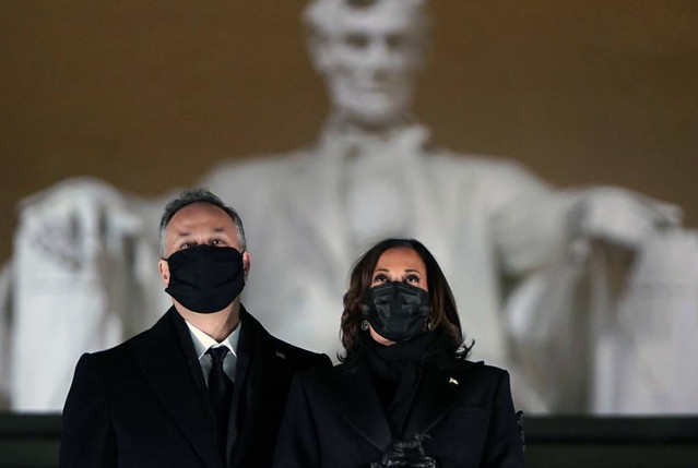U.S. Vice-President Kamala Harris and her husband Doug Emhoff attend a televised ceremony at the Lincoln Memorial