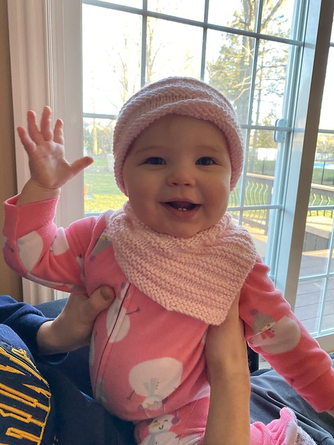 Isn't Pam's granddaughter adorable in the cowl and hat she knit her?