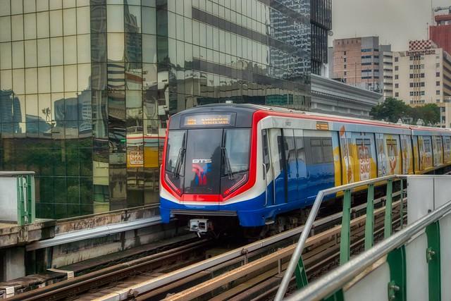 BTS Skytrain leaving Chit Lom station on Sukhumvit road in Bangkok, Thailand