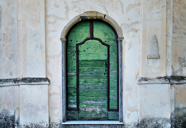 Madonna next to a green door