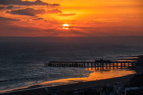 sunset sundown hastingspier hastings eastsussex beachyheadinthedistance sand reflections birds people tidesout