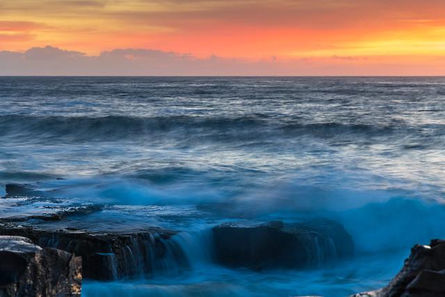 High Cloud Sunrise Seascape from Rock Platform