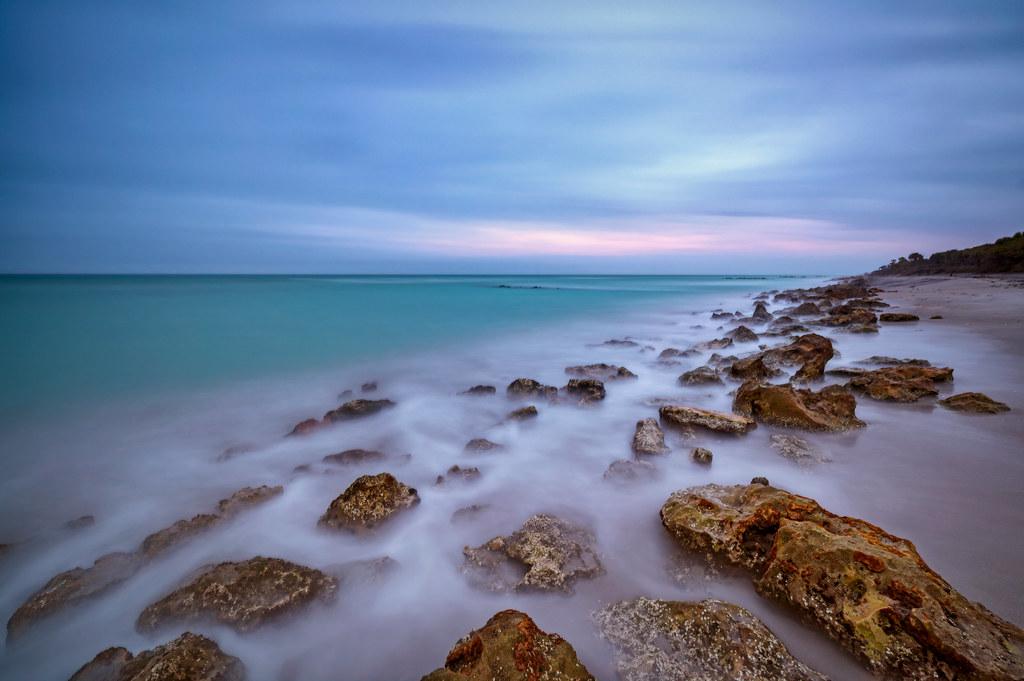 Long exposure of cloudy morning just before sunrise on Caspersen Beach near South Venice, Florida