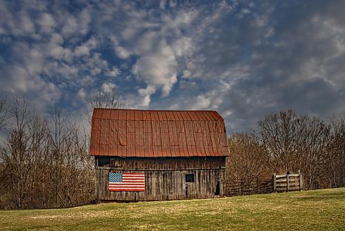 barn flag americanflag patriotic clouds winter landscape farm monroecounty lindside wv westvirginia tin bobbell nikon d750