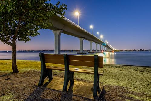 bench park parkbench view bridge causeway stuartcauseway tree shore water river insianriver dawn predawn mornglights starburst landscape seascape outdoors stuart martincounty florida usa