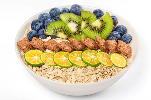 The concept of a delicious and healthy breakfast - oatmeal and fruits | by wuestenigel