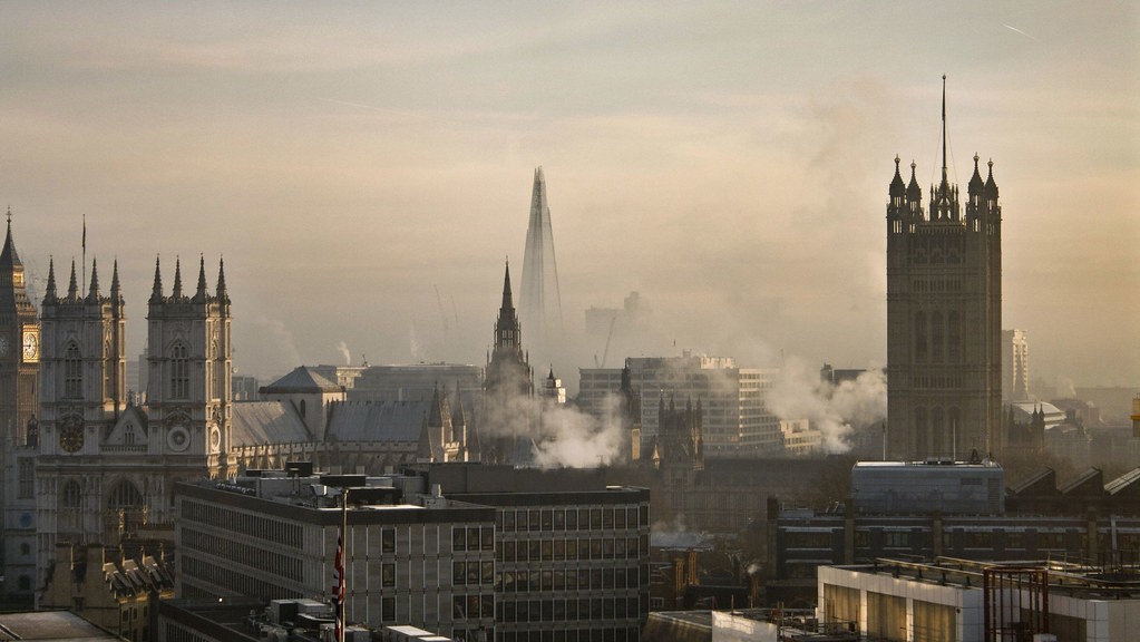 The London skyline with clouds of pollution rising in the morning sun.