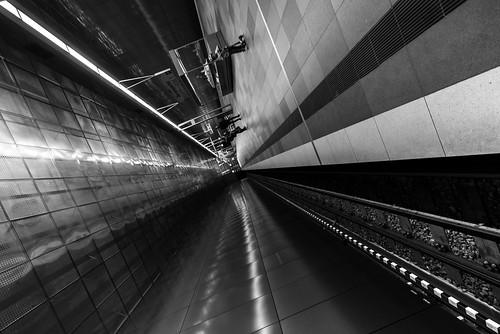 14mm 2020 bw d750 hamburg nikon samyang architecture diagonal dutch lines motion origin people station subway tilted überseequartier