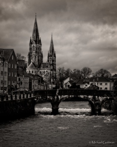 ireland cork churchexterior river bridge blackwhite southgatebridge riverlee saintfinbarrescathedral clouds water cathedral monochrome bw blackandwhite moody