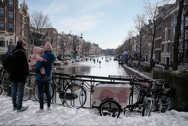 Unique view on skating people on the Amsterdam canals