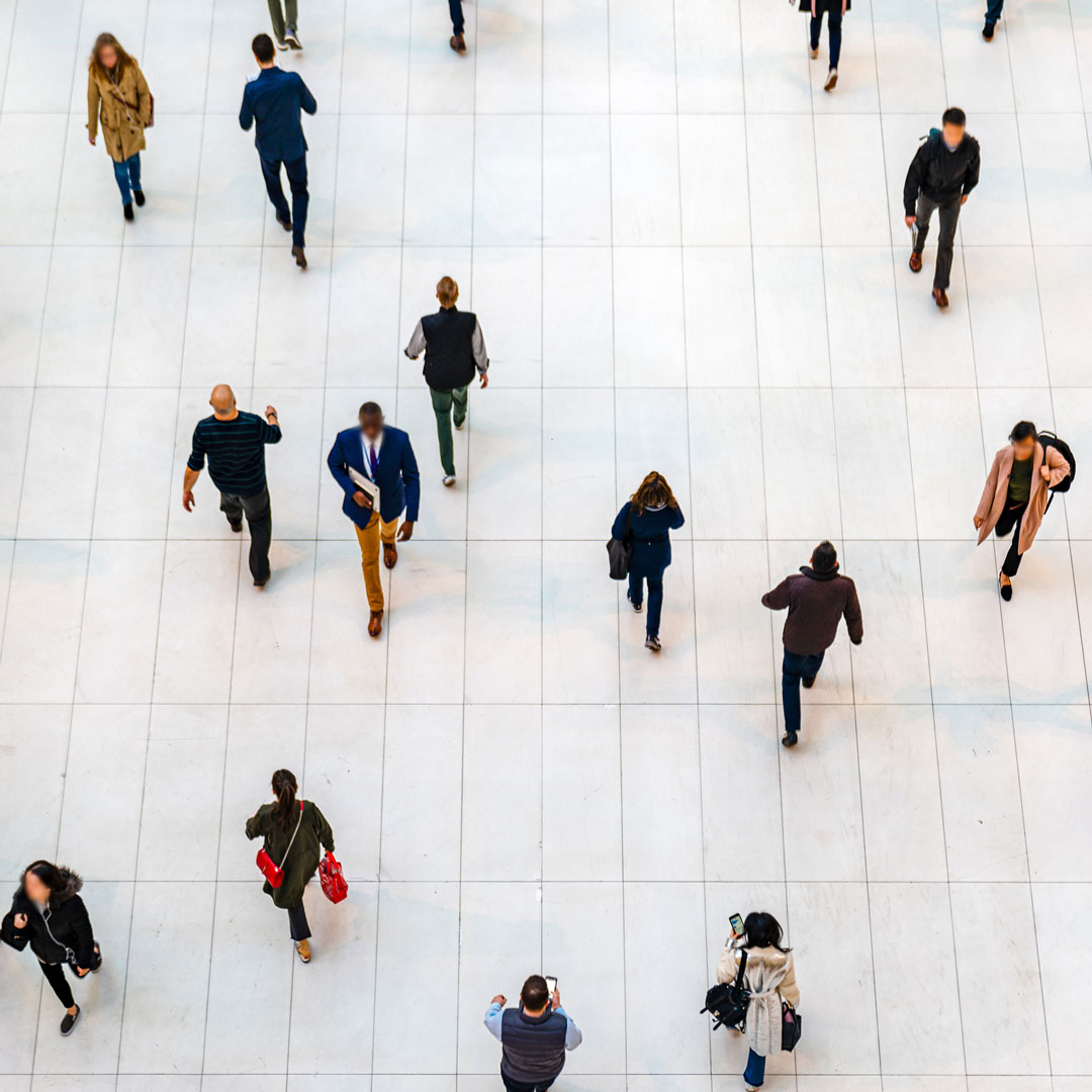 An aerial photo of people walking down a hall