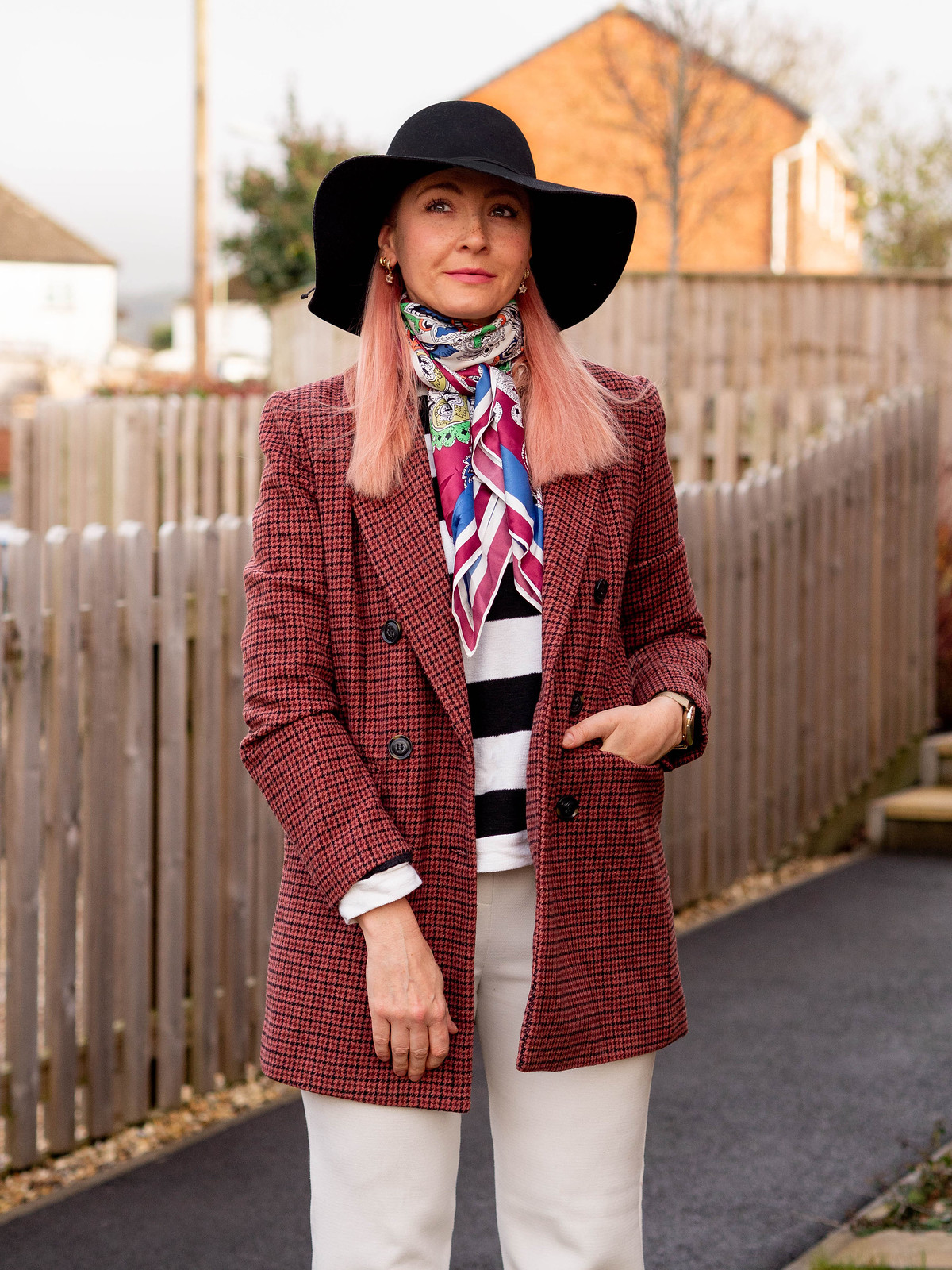 Wearing Black and White a Different Way: Catherine Summers of Not Dressed As Lamb wearing a red check double breasted jacket, black/white striped sweater, multicoloured neck scarf, floppy black hat, white trousers, black lace-up boots | Fashion Over 40