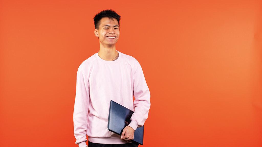 Godfrey holding his laptop