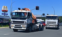 SemmyTrailer posted a photo:	An Isuzu 6x4 tractor unit with a Palfinger crane is turning right, maybe going to McDonalds, as a Foden 4400 6x4 tipper prepares to pass it on the inside.