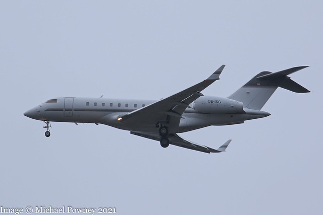 OE-IXG - 2005 build Bombardier BD700 Global Express 5000, on approach to Runway 23R at a dank, grey Manchester