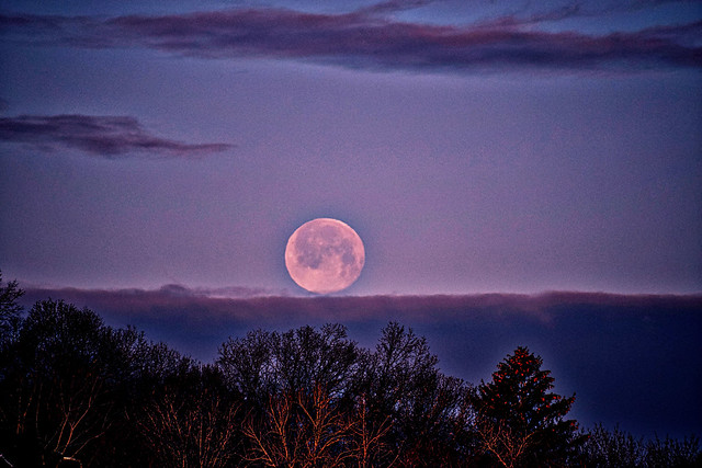 Wolf Moon touching low clouds