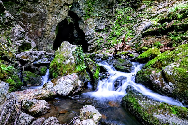 From a cave the river flows and spirits soar