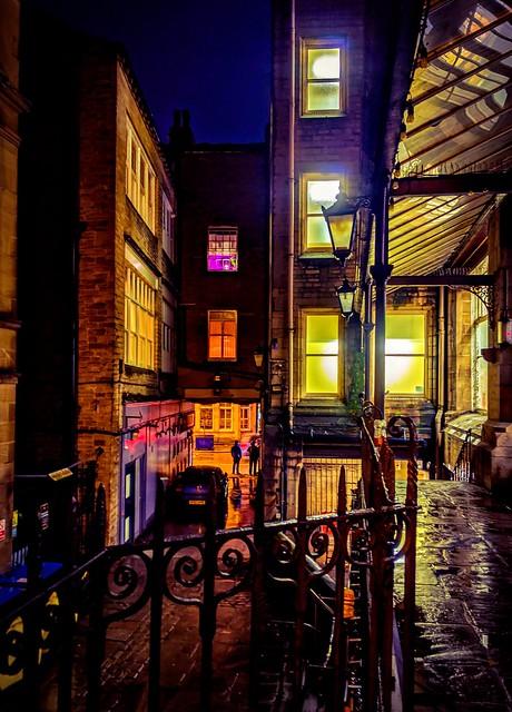 Lights, railings, reflections, rain. .