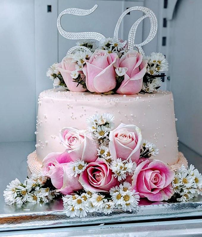 Cake by Cakelicious Bakery