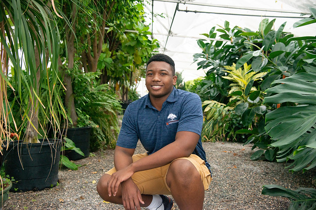 Johnathan Hampton in a greenhouse.