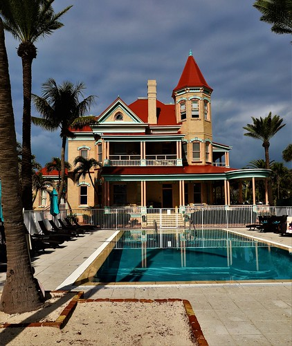 southernmosthouse inthecontinentalus historicinn usa florida unitedstates keywestflorida 1400duvalstreet monroecounty 5presidentsstayedhere built1896 for250000 privateresidence 1939~cubannightclub cafecayohueso backtoaresidencefrom1954to1996 1996~3millionrenovation toaneighteenroomhotel southernmosthousehistoricinn northernroofdesign~slopedforsnowfall ithasneversnowedinkeywest veryelegant building architecture pool outdoor beachhouse victorianstylemansion oldtownkeywest tree water winterinflorida tourists waterfront widowswalk balcony victorianmansion bedbreakfast 1896 thesouthernmosthouse 18rooms 12420 oceanbackyard reflection fencing poolside beach victoriancirca1896