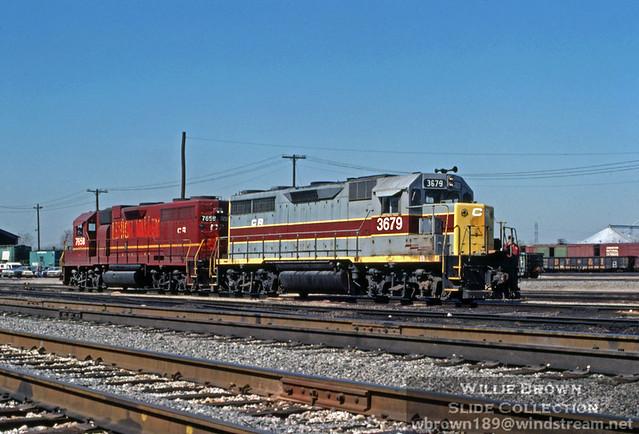 GP35 3679 & GP38AC 7658  28 days into Conrail on 4/28/76 at Sharonville, Ohio.