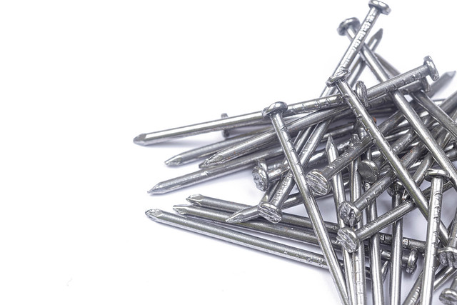 Pile of Nails above white background