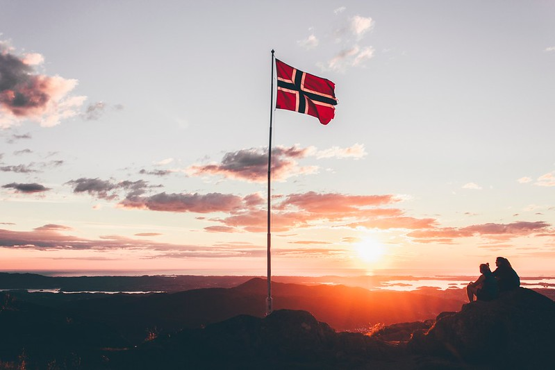 Mountain top with Norwegian flag