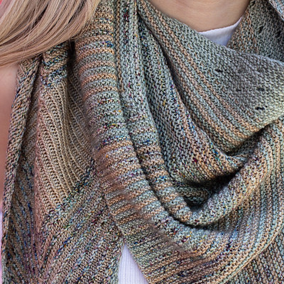 The Temperance Shawl by Malabrigo uses one skein each of 3 colours of Malabrigo Sock or Mechita and 4 mm (US 4) needles.